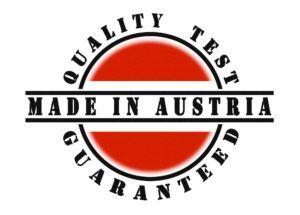 runde österreich-flagge mit Qualitätszeichen